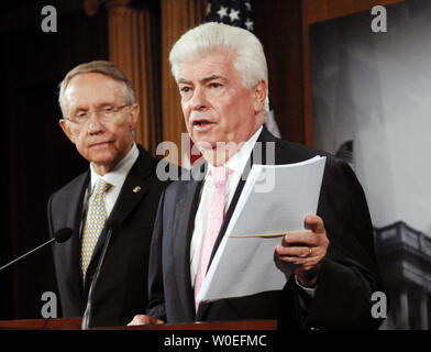 Senate Majority Leader Harry Reid (D-NV) (L) and Chairman of the Senate Banking, Housing and Urban Affairs Committee Sen. Christopher Dodd (D-CT) speak at a press conference about the proposed $700 billion bailout of financial markets on Capitol Hill in Washington on September 26, 2008. Sen. Dodd holds a copy of the draft bill Congressional leaders were working on together, before consensus on the draft fell apart yesterday, after a meeting with U.S. President George W. Bush at the White House. (UPI Photo/Alexis C. Glenn)