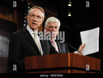 Senate Majority Leader Harry Reid (D-NV) (L) and Chairman of the Senate Banking, Housing and Urban Affairs Committee Sen. Christopher Dodd (D-CT) speak at a press conference about the proposed $700 billion bailout of financial markets on Capitol Hill in Washington on September 26, 2008. Sen. Reid holds a copy of the draft bill Congressional leaders were working on together, before consensus on the draft fell apart yesterday after a meeting with U.S. President George W. Bush at the White House. (UPI Photo/Alexis C. Glenn)