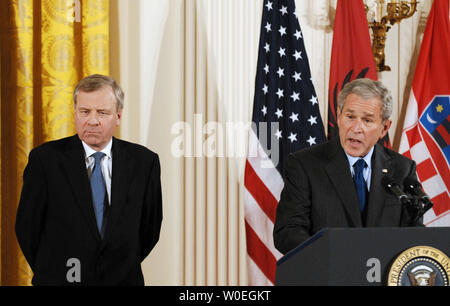 U.S. President George W. Bush speaks at a signing ceremony for NATO Accession Protocols for Albania and Croatia, as NATO Secretary General Jaap de Hoop Scheffer of the Netherlands looks on, in the East Room of the White House in Washington on October 24, 2008. (UPI Photo/Alexis C. Glenn) - Stock Photo