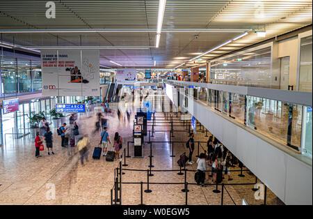 Geneva, Switzerland - 06/27/2019 : Planes and traffic on the Tarmac at an international Airport. - Stock Photo