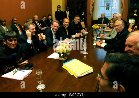 Speaker of the House Nancy Pelosi (D-CA) (4th-R), House Majority Leader Steny Hoyer (D-MD) (3rd-R) and other representatives meet with Alan Mulally (2nd-L), President and CEO of Ford Motor Co., Rick Wagoner (3rd-LL), CEO of General Motors Corp., Robert Nardelli (4th-L), Chairman and CEO of Chrysler LLC and Ron Gettelfinger (5th-L), President of the United Auto Workers Union, in her office on Capitol Hill in Washington on November 6, 2008. The automakers were discussing the possibility of a government bailout. (UPI Photo/Kevin Dietsch) - Stock Photo