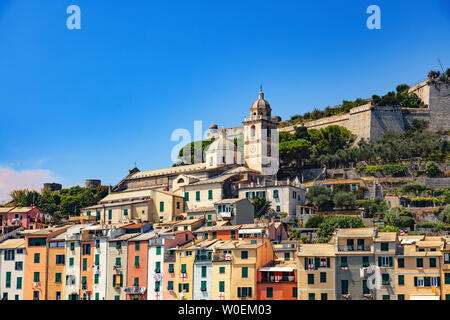 Portovenere, Cinque Terre, Liguria, Italy - 09 August 2018 - Panorama of colorful picturesque harbour of Porto Venere with San Lorenzo church, Doria Castle and Gothic Church of St. Peter - Stock Photo