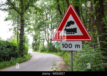 Dutch warning road sign with train meaning level crossing without barrier or gates ahead - Stock Photo