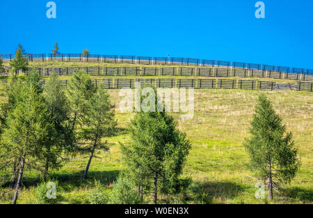 France, Hautes-Pyrénées, Col de Peyressourde (1569 meters high), state forest of Peyressourde (protection guards anti-avalanche and anti-mudflow), snow fence - Stock Photo