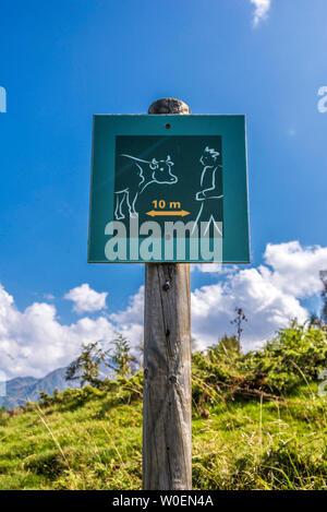 France, Hautes-Pyrénées, Col de Val Loouron-Azet (1580 meters high) between the Vallée d'Aure and the Vallée du Louron, signs encouraging the protection of the herds - Stock Photo