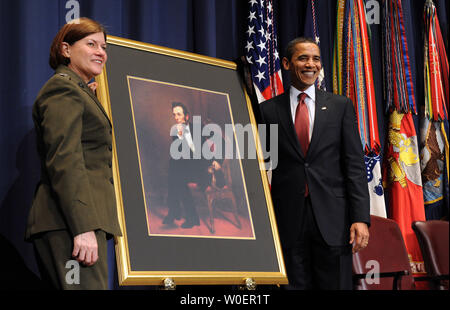 U.S. President Barack Obama and Lt. Gen. Frances C. Wilson, United States Marine Corps, president of the National Defense University, unveil a portrait of Abraham Lincoln during the dedication of the Abraham Lincoln Hall at the National Defense University at Ft. McNair in Washington on March 12, 2009.    (UPI Photo/Roger L. Wollenberg) - Stock Photo