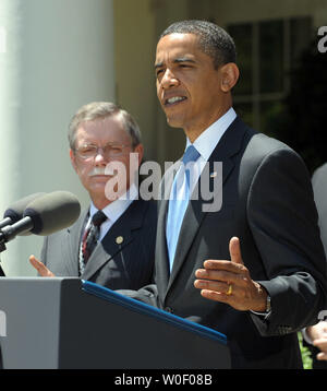 U.S. President Barack Obama announces tightening of auto emissions and efficiency standards in the Rose Garden of the White House in Washington on May 19, 2009. At left is United Autos Workers President Ron Gettlefinger.   (UPI Photo/Roger L. Wollenberg) - Stock Photo