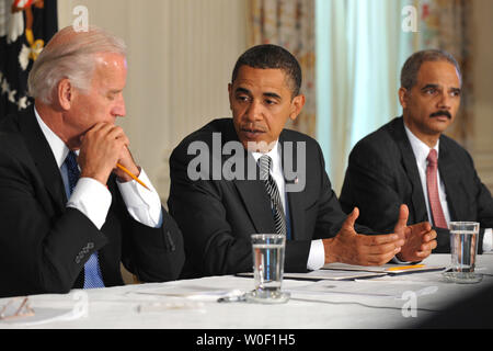 President Barack Obama (C) speaks alongside Vice President Joe Biden (L) and Attorney General Eric Holder during a Cabinet meeting at the White House in Washington on June 8, 2009. (UPI Photo/Kevin Dietsch) - Stock Photo
