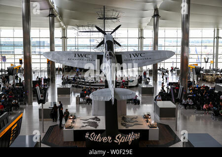 London, UK. 26th June, 2019. A World War II Silver Spitfire inside the Heathrow Airport. The Spitfire is a British single-seat fighter aircraft that was used by the Royal Air Force and many other Allied countries before, during and after World War II. The Spitfire was built in many variants, using several wing configurations, and was produced in greater numbers than any other British aircraft. It was also the only British fighter to be in continuous production throughout the war. Credit: Dinendra Haria/SOPA Images/ZUMA Wire/Alamy Live News - Stock Photo