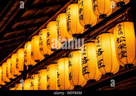 Row of lantern illuminating the temple at night time, Kodai ji, Kyoto, Japan - Stock Photo