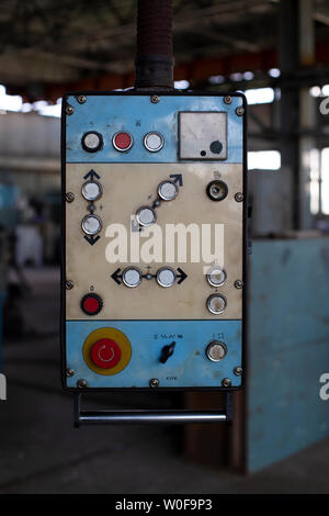 Retro control panel for machinery in an old factory. Closeup of the old control panel. - Stock Photo