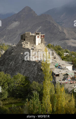 Pakistan, Gilgit Baltistan, Karimabad City, Hunza Valley, View of Karimabad City and Baltit Fort of 13th Century Tibetan Architecture Overlooking the City - Stock Photo