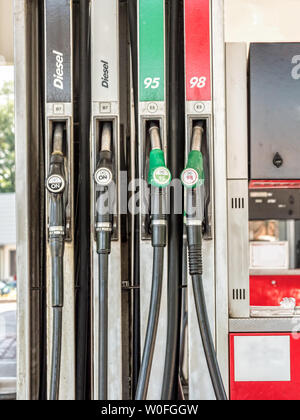 Petrol station pumps with diesel, unleaded 95 and 98 fuel distributor - Stock Photo