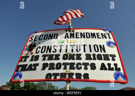 A pro-gun sign is seen at a second amendment rally in Washington on April 19, 2010. Pro-gun rallys where held around the country today, also known as Patriots' Day, the anniversary of the American Revolutionary War battles of Lexington and Concord and the Oklahoma City bombing.     UPI/Kevin Dietsch - Stock Photo