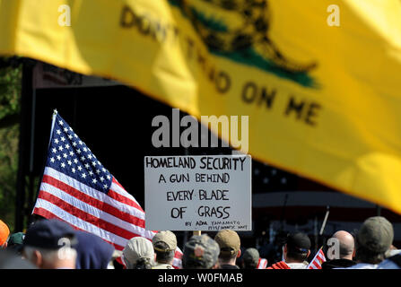 A pro-gun sign is seen at a second amendment rally on the grounds of the Washington Monument, in Washington on April 19, 2010. Pro-gun rallys where held around the country today, also known as Patriots' Day, the anniversary of the American Revolutionary War battles of Lexington and Concord and the Oklahoma City bombing.    UPI/Kevin Dietsch. - Stock Photo