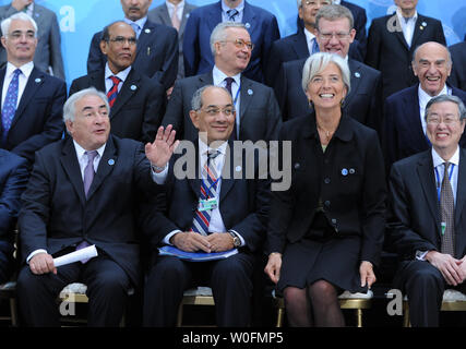 Members of International Monetary and Financial Committee (IMFC) gather for a group photo during the International Monetary Fund (IMF) and World Bank Spring Meetings in Washington on April 24, 2010. Seated (front row, L to R) are IMF Managing Director Dominique Strauss-Kahn, IMFC Chairman Youssef Boutros-Ghali, and French Finance Minister Christine Lagarde, and Chinese Finance Minister Zhou Xiaochuan.  In the second row (L to R) are British Finance Minister Alistair Darling, Reserve Bank of India chief Duvvuri Subbarao, Italian Finance Minister Giulio Tremonti, Russian Finance Minister Alexei - Stock Photo
