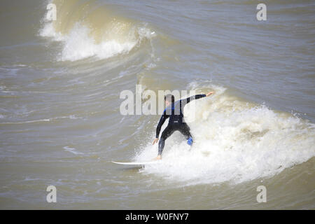 Eastbourne, East Sussex. 27th Jun 2019. UK Weather:.Surfers enjoy the summer sun today in Eastbourne,East Sussex,Uk. Credit:Ed Brown/Alamy Live News - Stock Photo