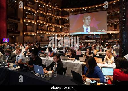 Washington, DC, USA. 27th June, 2019. Reporters work at the media center for Democratic Party's first primary debate in Miami, Florida, the United States, June 26, 2019. Ten Democratic contenders for the 2020 U.S. presidency took the stage in Miami on Wednesday night for the party's first primary debate, a two-night event scheduled to be attended by 10 others on Thursday. Credit: Xinhua/Alamy Live News - Stock Photo