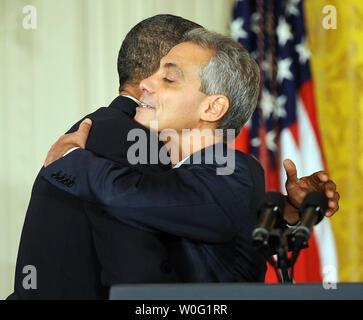 U  S  President Barack Obama (R) hugs Chicago Mayor Rahm Emanuel
