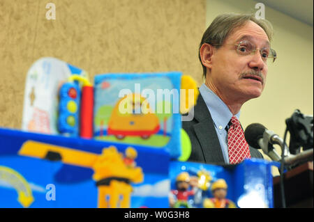U.S. Consumer Product Safety Commissioner Robert Adler speaks during a news conference at which U.S. Public Interest Research Group (PIRG) announced its 25th annual Trouble in Toyland report, in Washington November 23, 2010. The report details test results for toxic chemicals in toys and calls to expand the small parts standard to prevent choking hazards.  UPI/Kevin Dietsch - Stock Photo