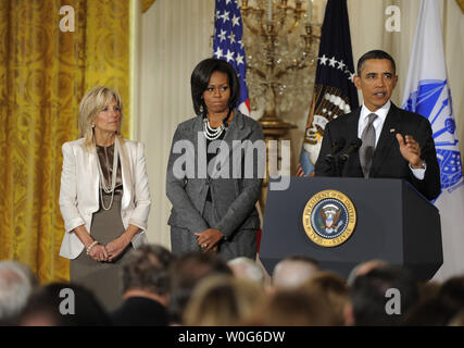 U.S. President Barack Obama makes remarks as he unveils a new initiative for military families, as First Lady Michelle Obama (C) and Dr. Jill Biden, wife of Vice President Joe Biden, also attend in the East Room of the White House, January 24, 2011 in Washington,D.C. Obama called for an effort to better coordinate and strengthen the Federal government's support for troops in the areas of education, housing, health care and quality of life issues.   UPI/Mike Theiler - Stock Photo