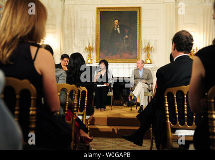 Poets Rita Dove and Billy Collins speak to students from around the country at a White House poetry, music and arts workshop held by First Lady Michelle Obama at the White House in Washington on May 11, 2011. - Stock Photo