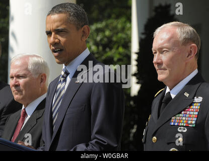 U.S. President Barack Obama makes remarks as he announces the nomination of Army Gen. Martin E. Dempsey (R) as chairman of the Joint Chiefs of Staff, and Defense Secretary Robert Gates attends (L), May 30, 2011 in the Rose Garden of the White House, in Washington, D.C. Adm. James Alexander 'Sandy' Winnefeld, Jr.. Dempsey, who will replace out-going Adm. Mike Mullen, will be the military's highest ranking officer and oversee the drawdowns in Iraq and Afghanistan, defense budget cuts and the future role of the armed forces.     UPI/Mike Theiler - Stock Photo