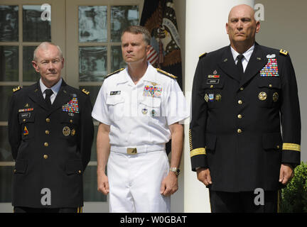 (L-R) US Army Gen. Martin E. Dempsey, nominated as the next chairman of the Joint Chiefs of Staff, Adm. James Alexander 'Sandy' Winnefeld, Jr., next vice chairman of JCS and Gen. Raymond Odierno, the next Army Chief of Staff, listen to remarks by President Barack Obama,  May 30, 2011 in the Rose Garden of the White House, in Washington, D.C. Dempsey, who will replace out-going Adm. Mike Mullen, will be the military's highest ranking officer and oversee the drawdowns in Iraq and Afghanistan, defense budget cuts and the future role of the armed forces.     UPI/Mike Theiler - Stock Photo