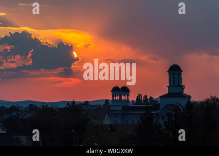 Spectacular sunset over Sts. Constantine and Helen Orthodox Church in Sibiu, Transylvania, Romania - Stock Photo
