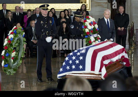 Vice President Joe Biden pays his respects to Sen. Daniel Inouye (D-HI) as he lies in state in the Capitol Rotunda in Washington, DC on December 20, 2012.  Sen. Inouye, the second-longest serving member of Senate, died Monday of respiratory complications.  UPI/Kevin Dietsch - Stock Photo