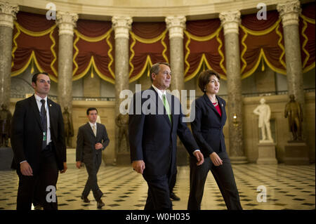 Speaker of the House John Boehner and Rep. Cathy McMorris Rodgers (R-WA) walk to the House chambers to vote on the Senate's Fiscal Cliff deal legislation on Capitol Hill in Washington, DC on January 1, 2013. The legislation passed 257-167. UPI/Kevin Dietsch - Stock Photo