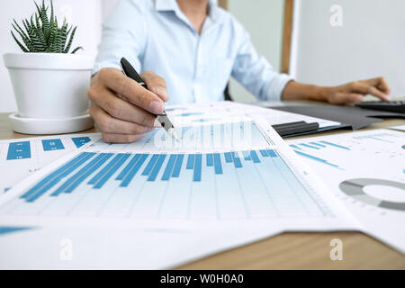 Businessman accountant making working audit and calculating expense financial annual financial report balance sheet statement, doing finance making no - Stock Photo