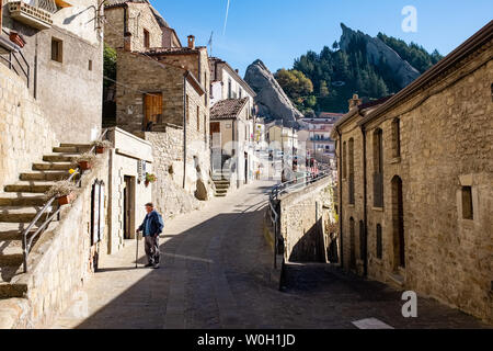 PIETRAPERTOSA, ITALY - NOVEMBER 13, 2018: Old man walks along an alley in the old centre of Pietrapertosa village. Basilicata region, Italy - Stock Photo