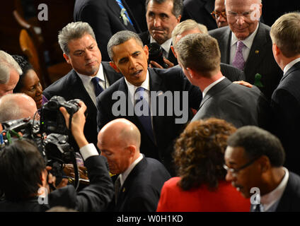 President Barack Obama greets audience members after delivering his State of the Union address during a joint session of Congress on February 12, 2013 at the U.S. Capitol Building in Washington, DC. UPI/Kevin Dietsch - Stock Photo