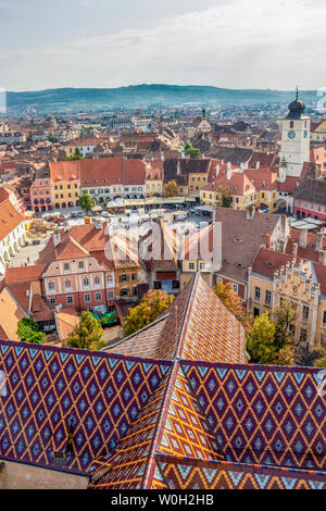 SIBIU, ROMANIA - AUGUST 28, 2017: Sibiu elevated cityscape with the Council Tower seen from the steeple of the Lutheran Cathedral of Saint Mary - Stock Photo