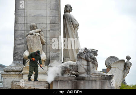 A National Park Service employee cleans the Christopher Columbus Memorial Fountain in front of Union State, on April 23, 2013 in Washington, D.C. UPI/Kevin Dietsch - Stock Photo
