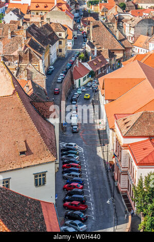 SIBIU, ROMANIA - AUGUST 28, 2017: View from Saint Mary Lutheran Cathedral of the house roofs at the old city of Sibiu, Romania, Transylvania - Stock Photo