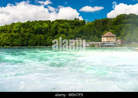 Neuhausen am Rheinfall, Switzerland - 23 July 2019. Waterfall on the river Rhine in Neuhausen am Rheinfall, in Switzerland. Visible old castle - Stock Photo