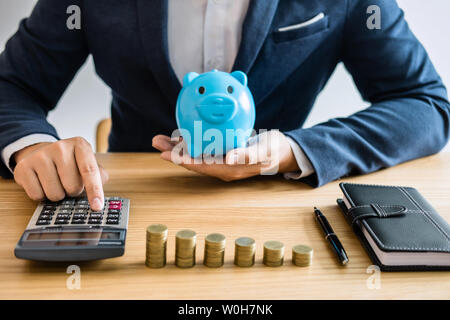 Coin stacks for step up growing business to profit and saving with piggy bank, Saving money for future plan and retirement fund concept. - Stock Photo