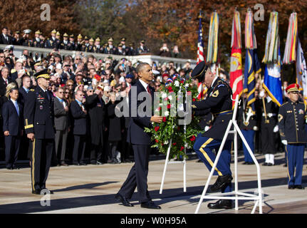 President Barack Obama, with Maj. Gen. Jeffrey S. Buchanan (L) of the U.S. Army Military District of Washington, places a wreath at the Tomb of the Unknowns during a Veterans Day ceremony at Arlington National Cemetery in Arlington, Va., November 11, 2013.  UPI/Molly Riley - Stock Photo