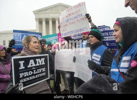 An anti-abortion supporter argues with supporters of women's rights groups as they participate in a rally in front of the Supreme Court as the Court considers two cases brought by Hobby Lobby and Conestoga Wood involving religious objections to the birth control mandate in the Affordable Care Act, in Washington, D.C. on March 25, 2014.  UPI/Kevin Dietsch - Stock Photo