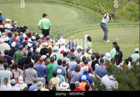 Tiger Woods hits off of the 10th tee during the second round of the Quicken Loans Nationals at Congressional Country Club, in Potomac, Maryland on June 27, 2014.  UPI/Kevin Dietsch - Stock Photo