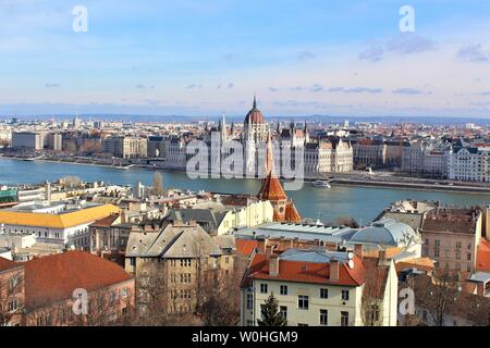 A view of the city of Budapest which is divided by the Danube river. In the centre is the Hungarian House of Parliament, which sits on the Pest side. - Stock Photo