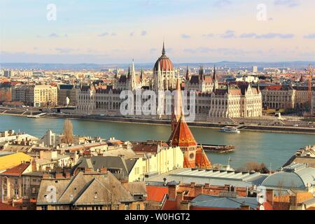 View across the Buda side of Budapest and the river Danube, of the Hungarian House of Parliament which sits on the Pest side of the Danube banks. - Stock Photo