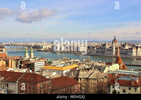 View of the Hungarian capital city of Budapest, including the iconic Danube River, House of Parliament and Margaret Bridge. - Stock Photo