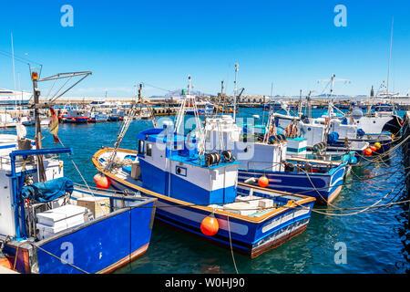 TARIFA, SPAIN - MAY 27, 2019: Port of Tarifa with fishing boats, Punta del Santo in the distance - Stock Photo