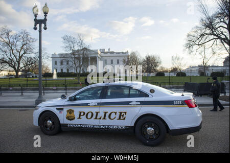 A U.S. Secret Service police car is seen in front of the White House, on December 18, 2014 in Washington, D.C. A report released by a Homeland Security panel stated that the Secret Service needs more training, staff and a leader from outside of the organization. UPI/Kevin Dietsch - Stock Photo
