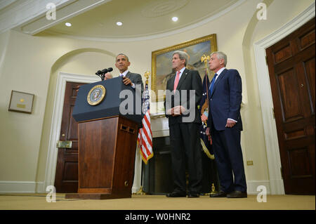 President Barack Obama speaks on requesting Congress to authorize military action against the Islamic State, at the White House in Washington, D.C. on February 11, 2015. Obama was joined by Secretary of State John Kerry and Secretary of Defense Chuck Hagel. Photo by Kevin Dietsch/UPI - Stock Photo