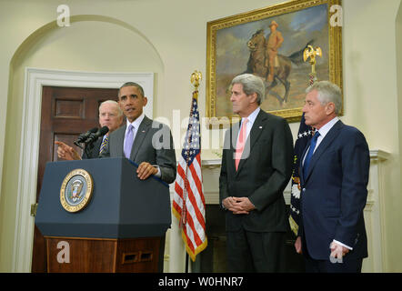 President Barack Obama speaks on requesting Congress to authorize military action against the Islamic State, at the White House in Washington, D.C. on February 11, 2015. Obama was joined by Vice President Joe Biden, Secretary of State John Kerry and Secretary of Defense Chuck Hagel. Photo by Kevin Dietsch/UPI - Stock Photo