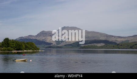 View across Loch Lomond to Ben Lomond from Luss,the conservation village on the shores of Loch Lomond built as a model village in 19C. - Stock Photo